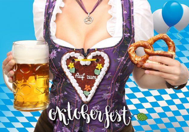 Frau mit Lebkuchenherz Brezel und Bier